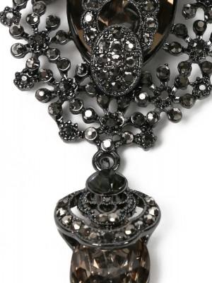 Брошь из металла декорированная кристаллами